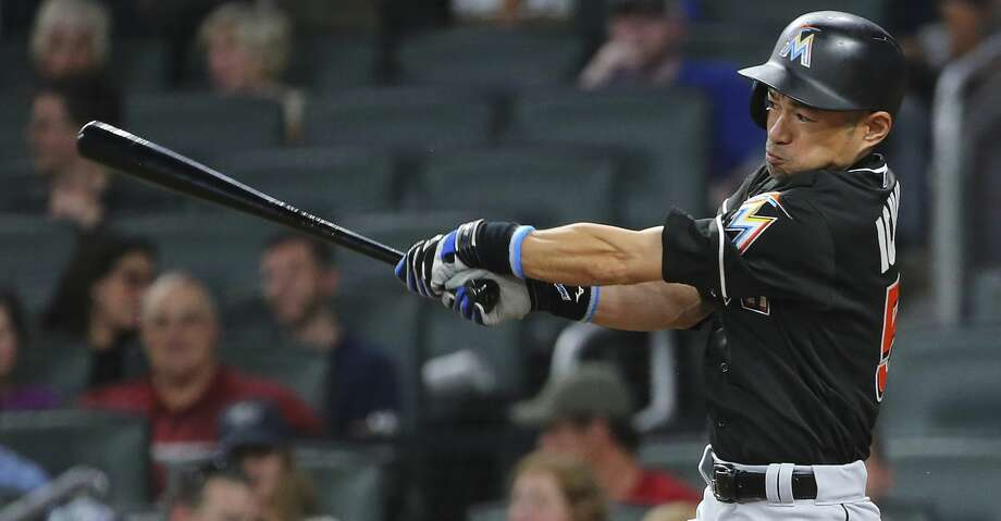 Miami Marlins pinch-hitter Ichiro Suzuki follows through on a base hit during the eighth inning of the team's baseball game against the Atlanta Braves on Friday, Aug. 4, 2017, in Atlanta. The Braves won 5-3. (AP Photo/John Bazemore) Photo: John Bazemore/Associated Press