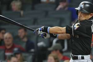 Miami Marlins pinch-hitter Ichiro Suzuki follows through on a base hit during the eighth inning of the team's baseball game against the Atlanta Braves on Friday, Aug. 4, 2017, in Atlanta. The Braves won 5-3. (AP Photo/John Bazemore)