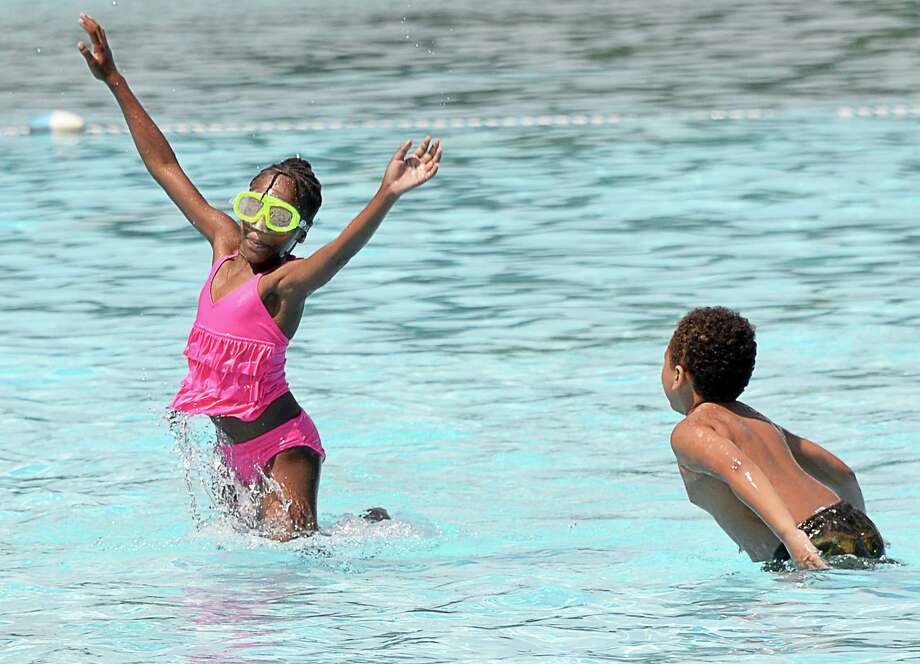 London Hayes, 9, left, and Jo-hon White, 5, both of Schenectady, keep cool playing in the Central Park pool Friday August 4, 2017 in Schenectady, NY.  (John Carl D'Annibale / Times Union) Photo: John Carl D'Annibale