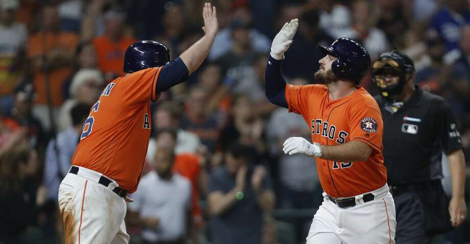Houston Astros Tyler White (13) celebrates his two-run home run with Brian McCann (16) during the sixth inning of an MLB game at Minute Maid Park, Friday, Aug. 4, 2017, in Houston. ( Karen Warren / Houston Chronicle ) Photo: Karen Warren/Houston Chronicle