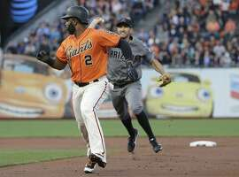 San Francisco Giants' Denard Span (2) is chased by Arizona Diamondbacks shortstop Adam Rosales, rear, before being tagged out during the first inning of a baseball game in San Francisco, Friday, Aug. 4, 2017. (AP Photo/Jeff Chiu)