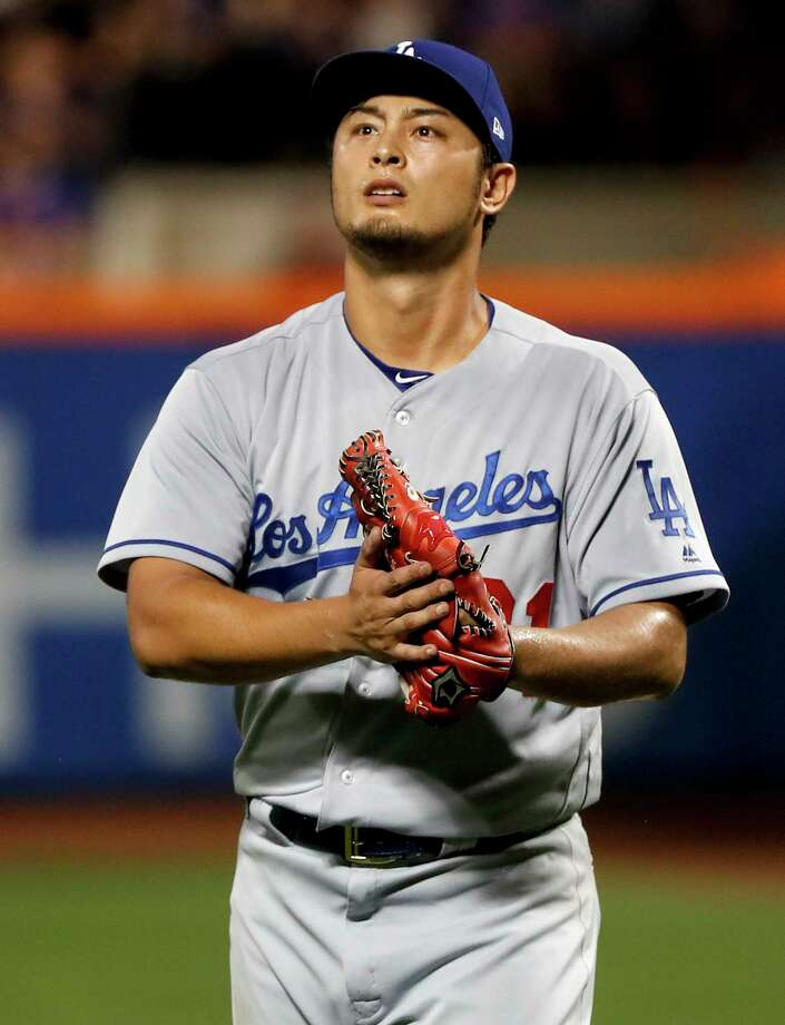 Los Angeles Dodgers starting pitcher Yu Darvish walks off the field at the end of the seventh inning of the team's baseball game against the New York Mets, Friday, Aug. 4, 2017, in New York. (AP Photo/Julie Jacobson) ORG XMIT: NYM126 Photo: Julie Jacobson / Copyright 2017 The Associated Press. All rights reserved.