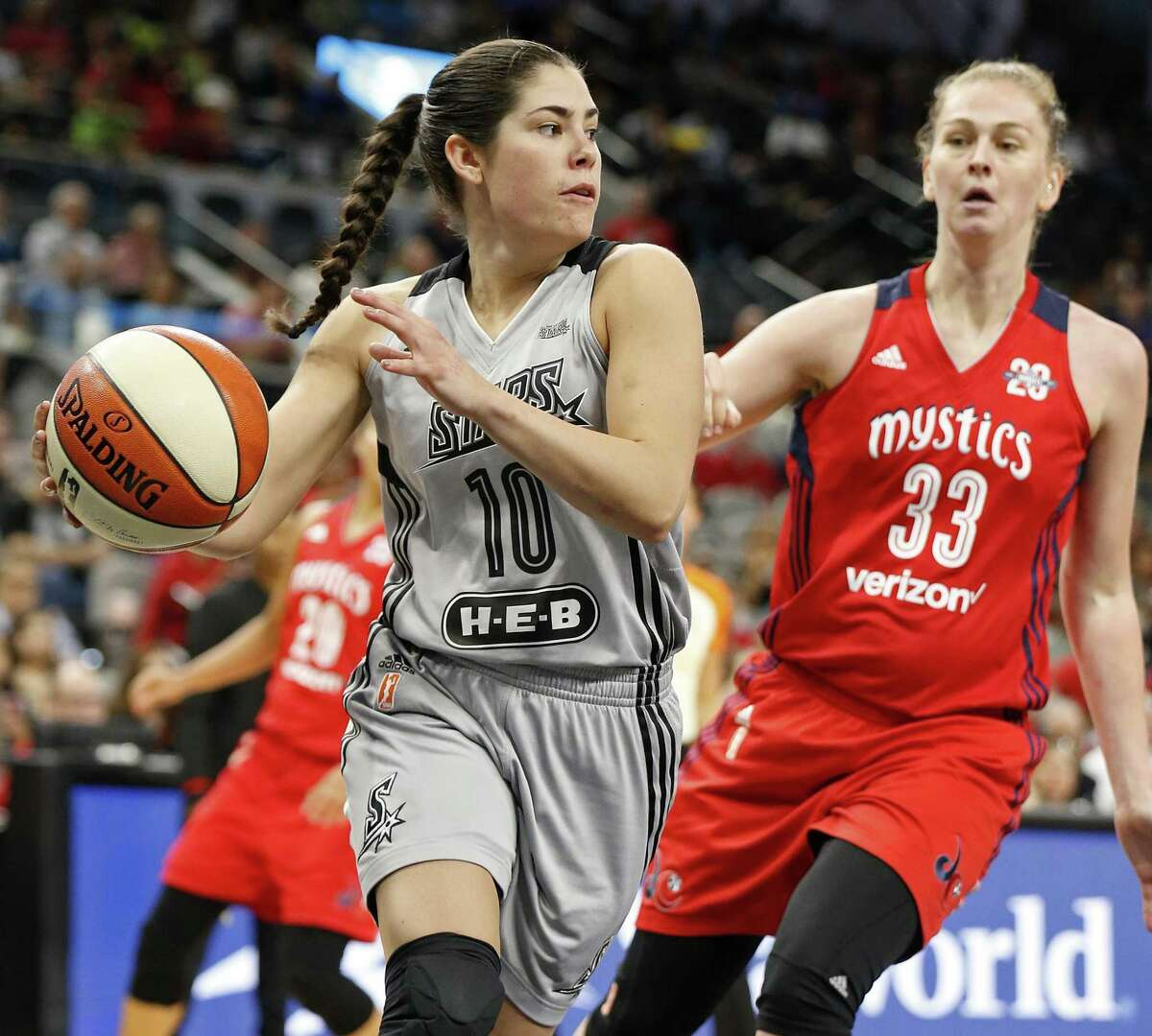 The Stars' Kelsey Plum looks to pass around Emma Meesseman. Plum scored nine points and had a career-high 12 assists.