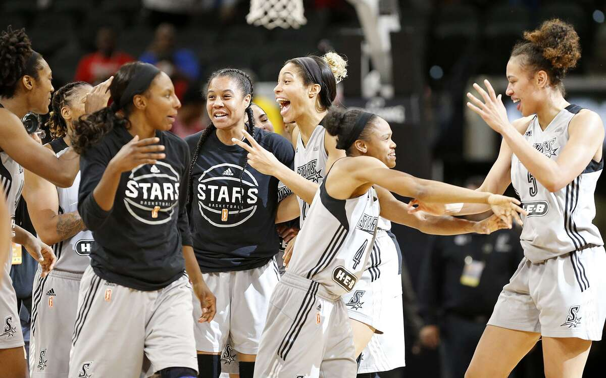 Members of the San Antonio Stars celebrate their 76-74 win over the Washington Mystics Friday Aug. 4, 2017 at the AT&T Center.