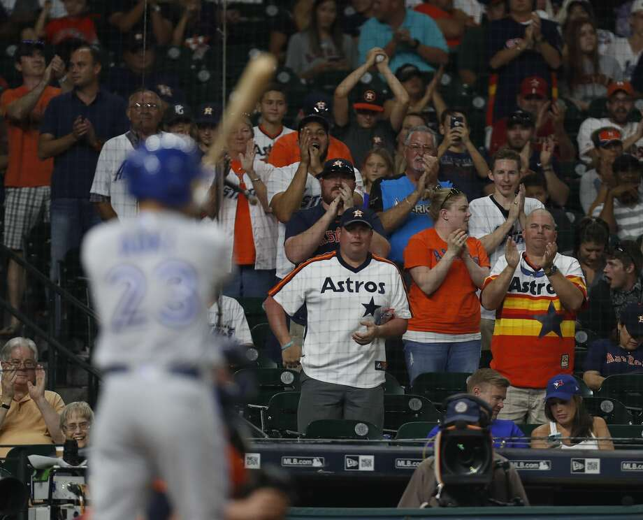 Houston Astros fans cheer the recently traded Toronto Blue Jays Norichika Aoki (23) batting during the ninth inning of an MLB game at Minute Maid Park, Friday, Aug. 4, 2017, in Houston. ( Karen Warren / Houston Chronicle ) Photo: Karen Warren/Houston Chronicle