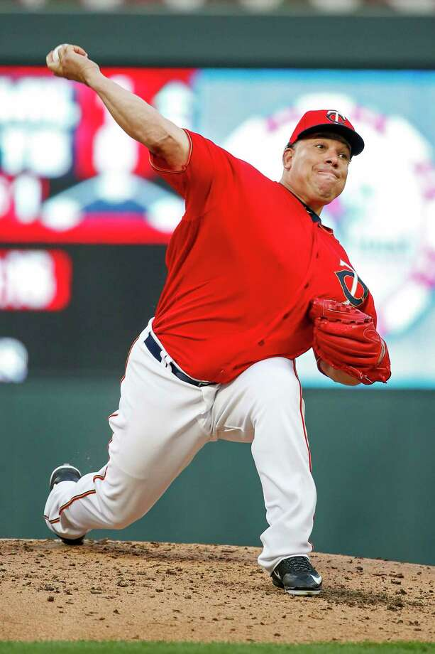 Minnesota Twins starting pitcher Bartolo Colon throws to the Texas Rangers in the second inning of a baseball game Friday, Aug. 4, 2017, in Minneapolis. (AP Photo/Bruce Kluckhohn) ORG XMIT: MNBK105 Photo: Bruce Kluckhohn / FR170893 AP