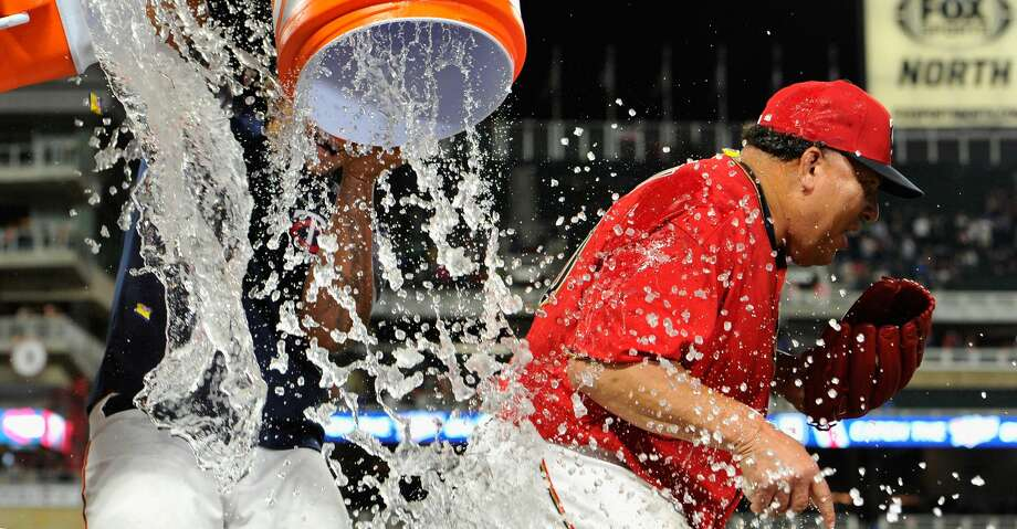 MINNEAPOLIS, MN - AUGUST 04: Bartolo Colon #40 of the Minnesota Twins is dunked with water by teammates after winning the game against the Texas Rangers on August 4, 2017 at Target Field in Minneapolis, Minnesota. The Twins defeated the Rangers 8-4. (Photo by Hannah Foslien/Getty Images) Photo: Hannah Foslien/Getty Images
