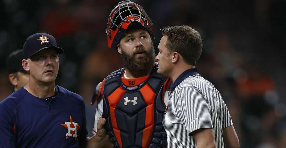 Houston Astros catcher Evan Gattis (11) is tended to after being hit by the back swing of Tampa Bay Rays Corey Dickerson during the eighth inning of an MLB game at Minute Maid Park, Thursday, Aug. 3, 2017, in Houston. ( Karen Warren / Houston Chronicle ) Photo: Karen Warren/Houston Chronicle