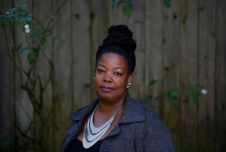 Tomiquia Moss, CEO of Hamilton Families in the courtyard at Hamilton Families transitional housing. Photo: Leah Millis, The Chronicle