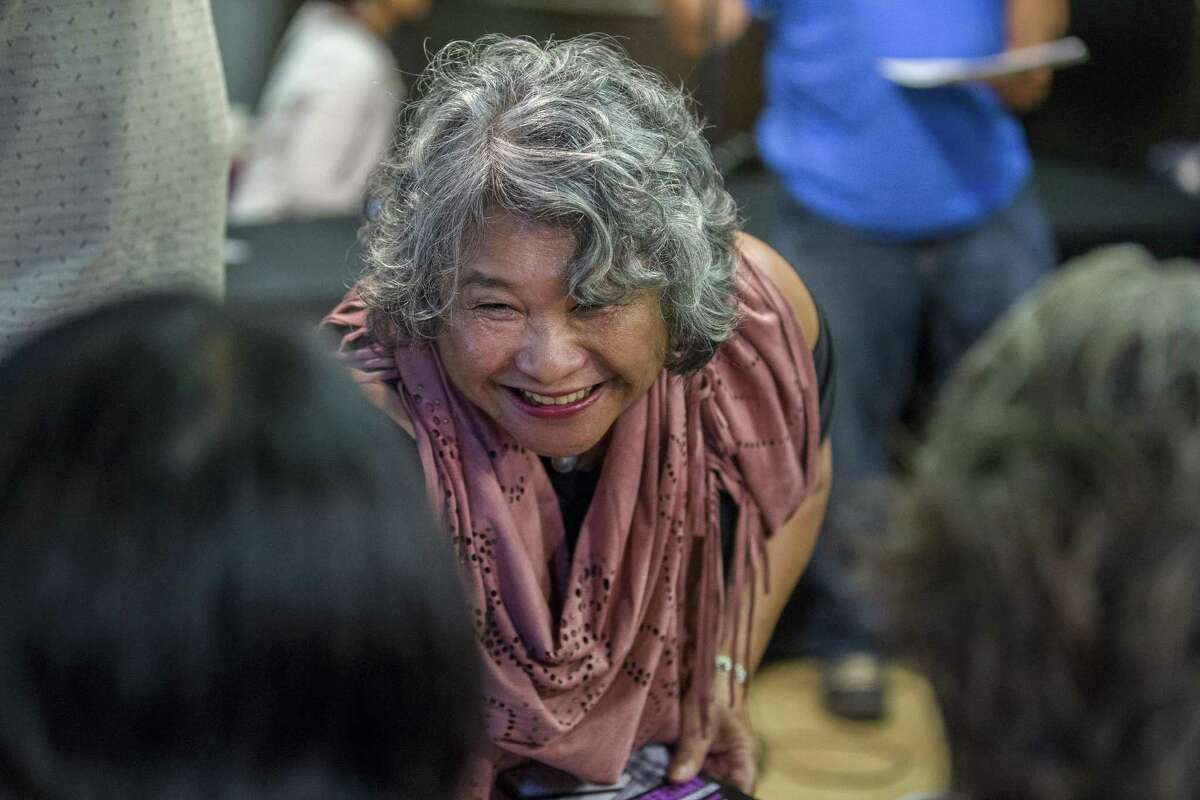 Pam Tau-Lee attends the Original Defenders panel at the I-Hotel Manilatown Center to mark the 40th anniversary of mass evictions.