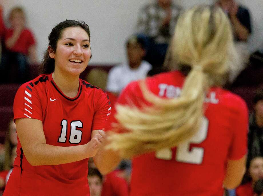 Tomball outside hitter Natalia Munoz (16) celebrates with setter Brooke Johnson (12) after a point during the fourth set of the District 20-5A high school volleyball championship at Magnolia High School Tuesday, Oct. 25, 2016, in Magnolia. Tomball defeated Magnolia 3-1. Photo: Jason Fochtman, Staff Photographer / Houston Chronicle