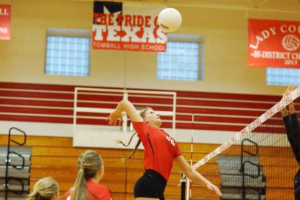 Tomball Volleyball junior middle blocker Kayla Cannon skies for a kill. Cannon has been an effective weapon for the Lady Cougars all season long, leading the team in kill percentage (40.4), racking up 147 kills through 35 matches.