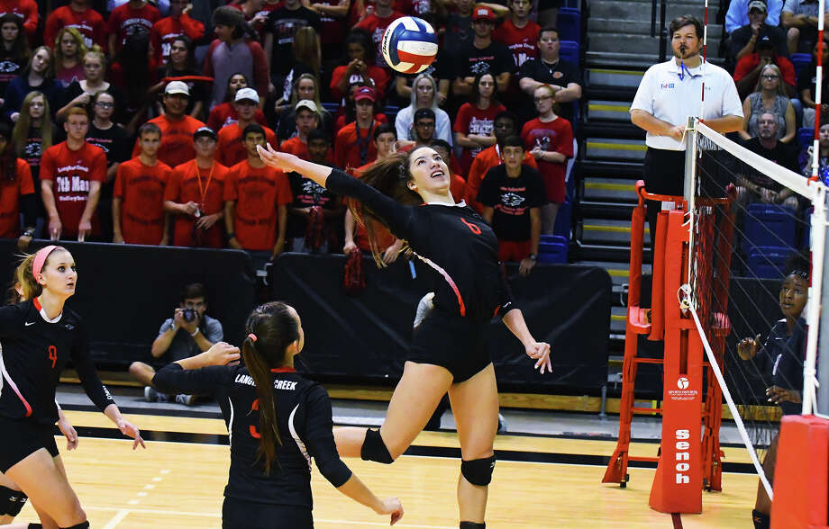 Langham Creek junior outside hitter Janna Skinner elevates for a kill against Lamar Tuesday at the Berry Center. Skinner had a terrific game in the blowout win, recording 10 kills and six blocks. Photo: Tony Gaines / HCN