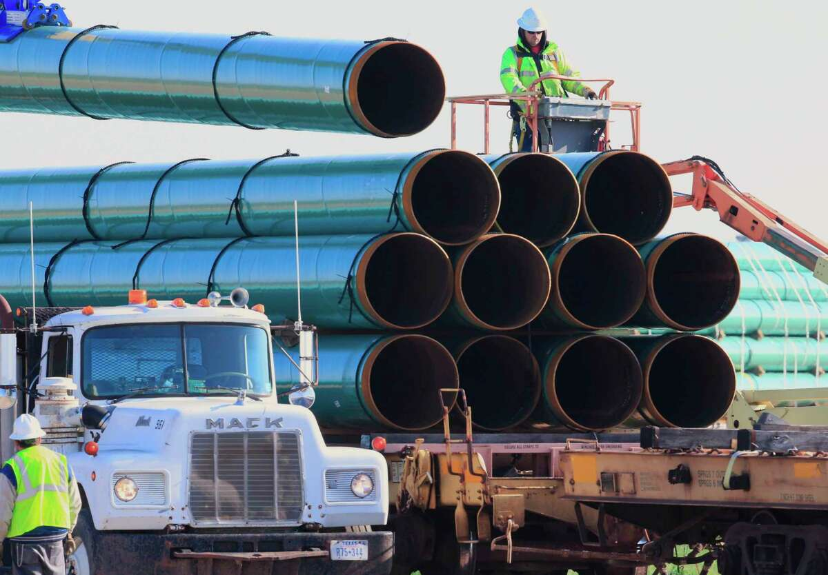 FILE - In this May 9, 2015, file photo, workers unload pipes in Worthing, S.D., for the Dakota Access oil pipeline that stretches from the Bakken oil fields in North Dakota to Illinois. A federal judge's order for more environmental review of the already-operating pipeline has several potential outcomes, all of which could spark even more wrangling in court. (AP Photo/Nati Harnik, File)