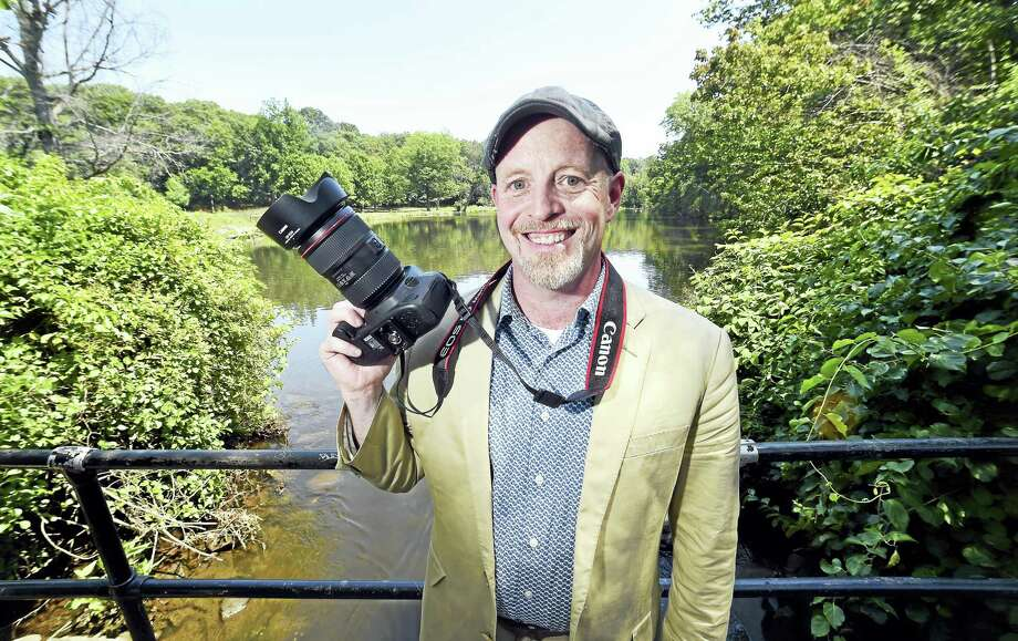 Photographer Chris Randall is photographed at the Duck Pond in Edgewood Park in New Haven on 8/3/2017.  Arnold Gold / Hearst Connecticut Media / New Haven Register