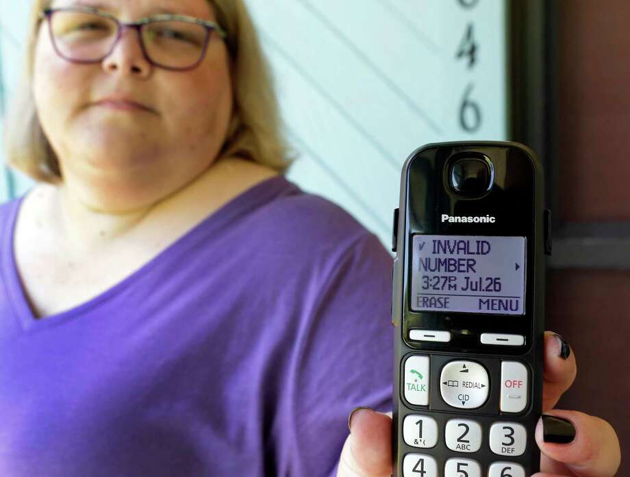Jen Vargas shows the data of a recent robocall on her home phone in Orlando, Fla. Vargas has an app for her cellphone that helps locate and block fraudulent calls, although she doesn't know what to do on the home phone other than ignore those calls. Photo: John Raoux, STF / Copyright 2017 The Associated Press. All rights reserved.