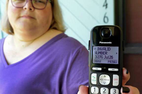 Jen Vargas shows the data of a recent robocall on her home phone in Orlando, Fla. Vargas has an app for her cellphone that helps locate and block fraudulent calls, although she doesn't know what to do on the home phone other than ignore those calls.