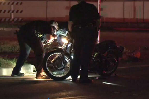 A motorcycle carrying two passengers collided with a pick-up truck Friday night in Tomball leaving one person in critical condition, authorities said.