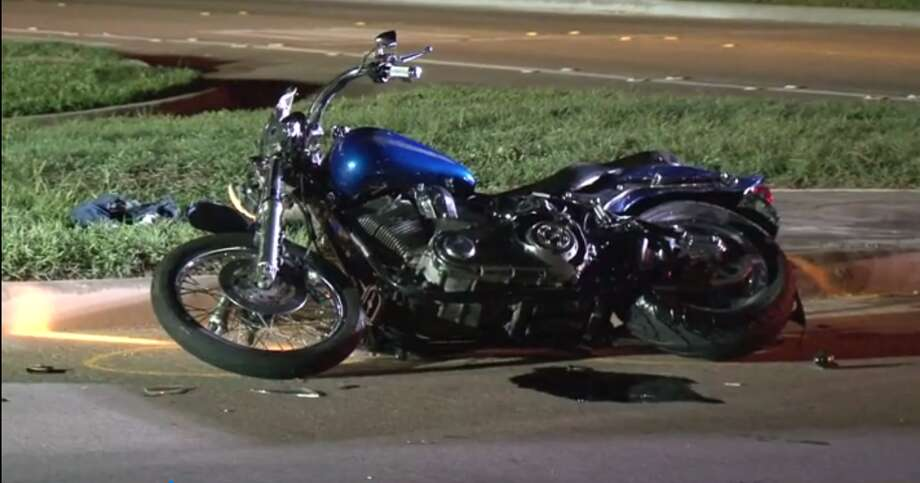 A motorcycle carrying two passengers collided with a pick-up truck Friday night in Tomball leaving one person in critical condition, authorities said. Photo: Metro Video