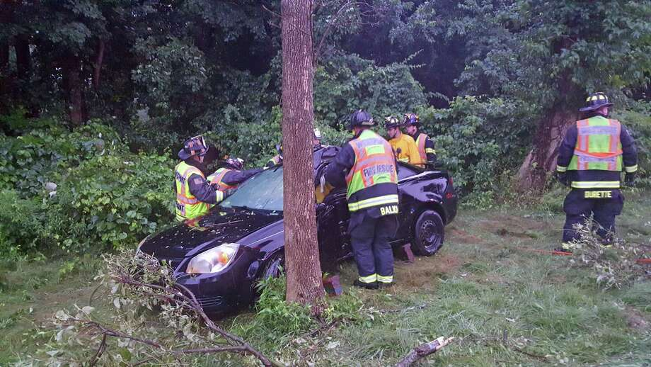 The Westport Fire Department responded to the Merritt Parkway around 6:35 a.m. Saturday, the department said. The call came in the midst of what the department said was torrential rain. Photo: Contributed Photo / Westport Fire Department / Contributed Photo / Connecticut Post Contributed