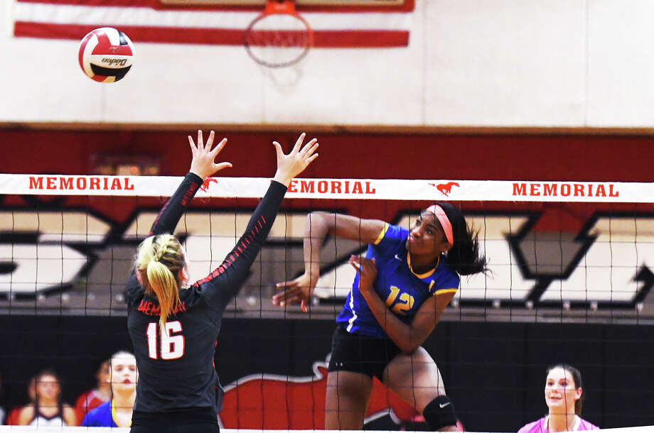 Klein sophomore middle blocker Nena Mbonu records one of her four kills in the district matchup with Memorial Tuesday. Mbonu finished with three digs and two blocks to go along with her four kills. Photo: Tony Gaines / HCN
