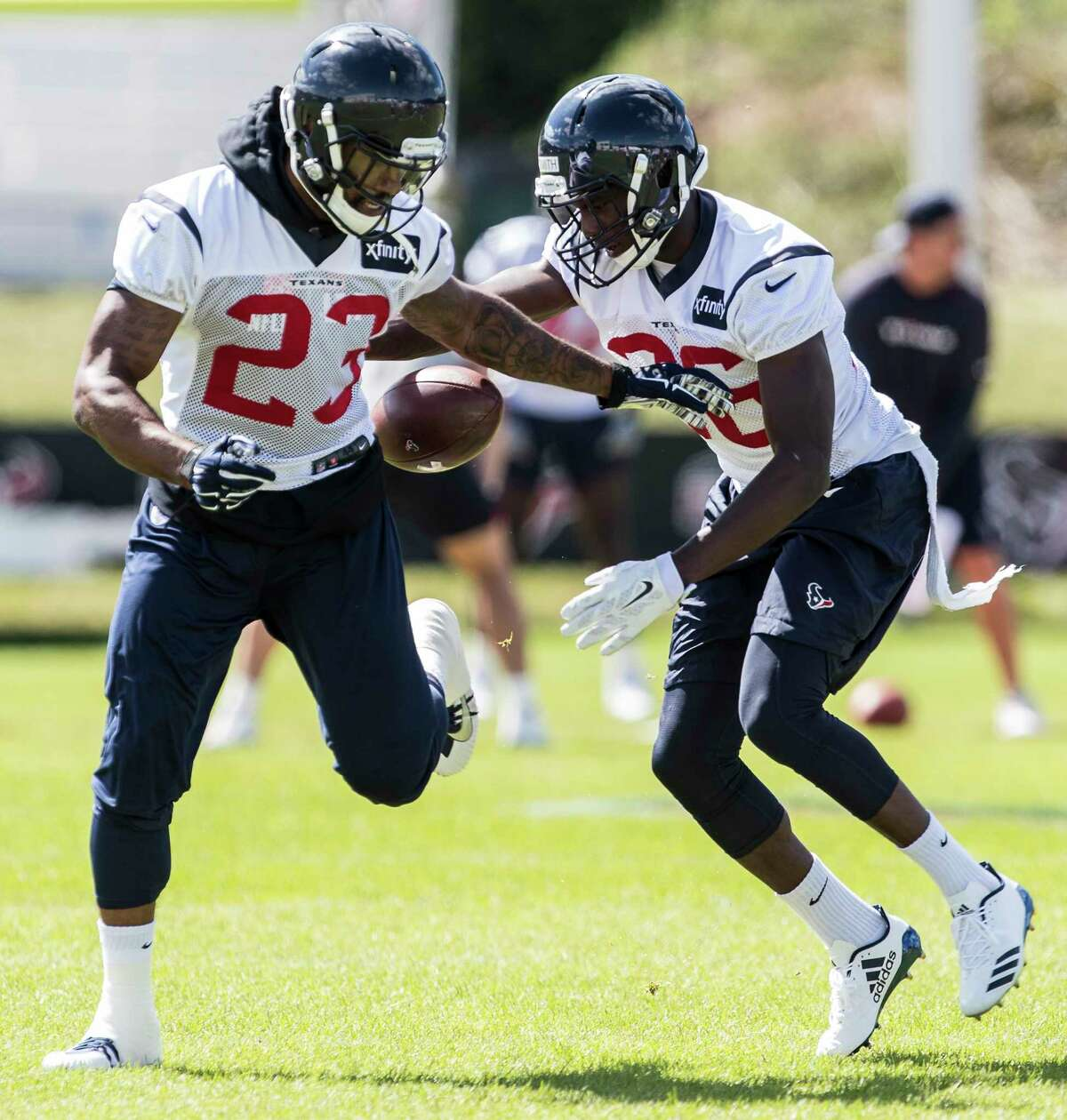 Houston Texans free safety Kurtis Drummond (23) and cornerback Malik Smith (36) fight for the ball as the run a coverage drill during training camp at the Greenbrier on Saturday, Aug. 5, 2017, in White Sulphur Springs, W.Va.