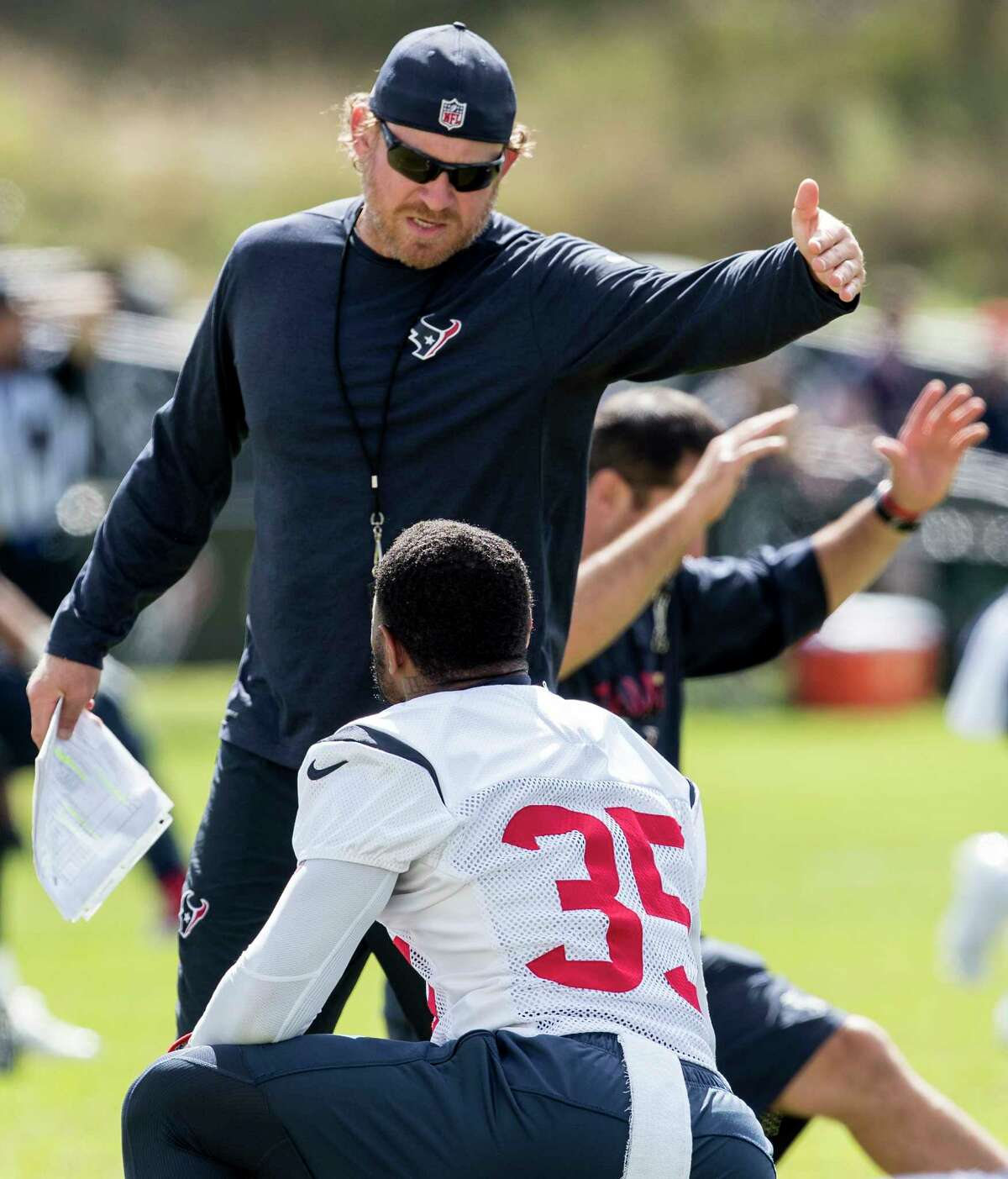 Houston Texans special teams coach Larry Izzo talks to defensive back Eddie Pleasant (35) during training camp at the Greenbrier on Saturday, Aug. 5, 2017, in White Sulphur Springs, W.Va.