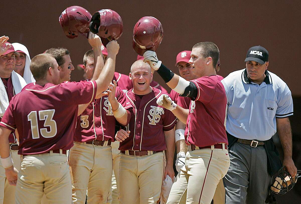 Florida State's Buster Posey, right celebrates with his teammates after hitting a grand slam in the third inning of a Tallahassee regional baseball game against Bucknell on Sunday, June 1, 2008 in Tallahassee, Fla. (AP Photo/Steve Cannon)