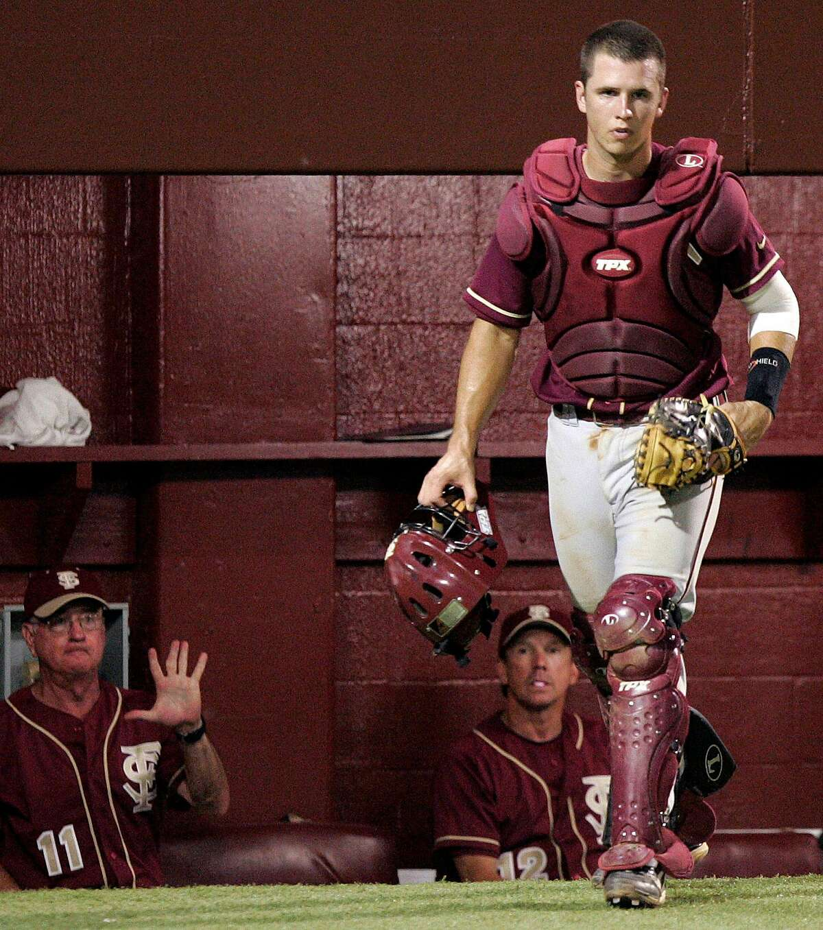 Florida State's Buster Posey heads out of the dugout in the fifth inning against Tulane in the championship baseball game of the Tallahassee Regional on Monday, June 2, 2008 in Tallahassee, Fla. Posey is projected to be one of the top draft picks when the Major League Baseball amateur draft starts Thursday.(AP Photo/Steve Cannon)