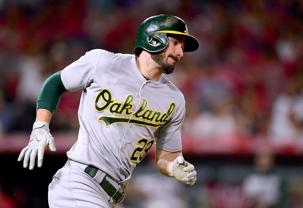 Matt Joyce #23 of the Oakland Athletics runs on his RBI double to take a 6-2 lead over the Los Angeles Angels during the sixth inning at Angel Stadium of Anaheim on August 4, 2017 in Anaheim, California. (Photo by Harry How/Getty Images)