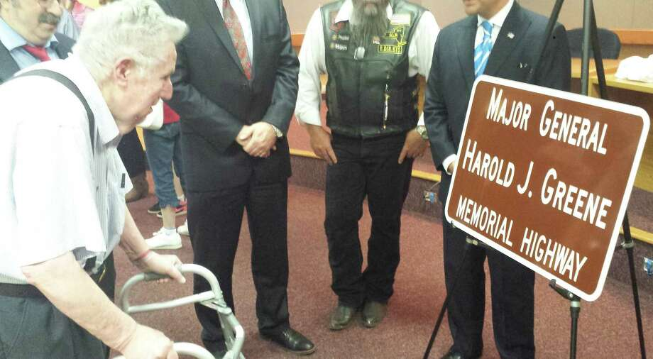 Guilderland's Harold Greene gets his first look at the highway sign  honoring his son. (Mark Grimm)
