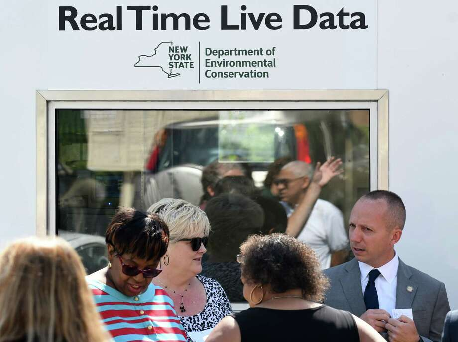 New York State Department of Environmental Conservation Commissioner Basil Seggos, right, stands next to a DEC air monitoring station at the Ezra Prentice Homes on Wednesday, July 26, 2017, on South Pearl Street in Albany, N.Y. State DEC has built a station that will collect air samples over the course of a year. (Will Waldron/Times Union) Photo: Will Waldron / 20041137A