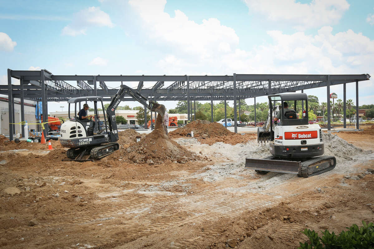 Construction workers continue progress on the Crossroads Shopping Center on Tuesday, Aug. 1, 2017, at the intersection of West Dallas and West Davis streets in Conroe.