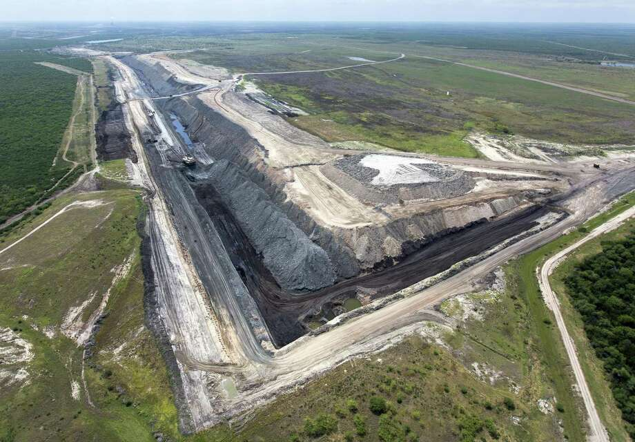 One of the sections of the San Miguel lignite coal strip mine near Campbellton is seen Wednesday, May 17, 2017 in an aerial image. The San Miguel Electric Cooperative's longtime lignite mine, which supplies the fuel for its nearby power plant, wants to expand its footprint in McMullen County. Photo: William Luther /San Antonio Express-News / © 2017 San Antonio Express-News