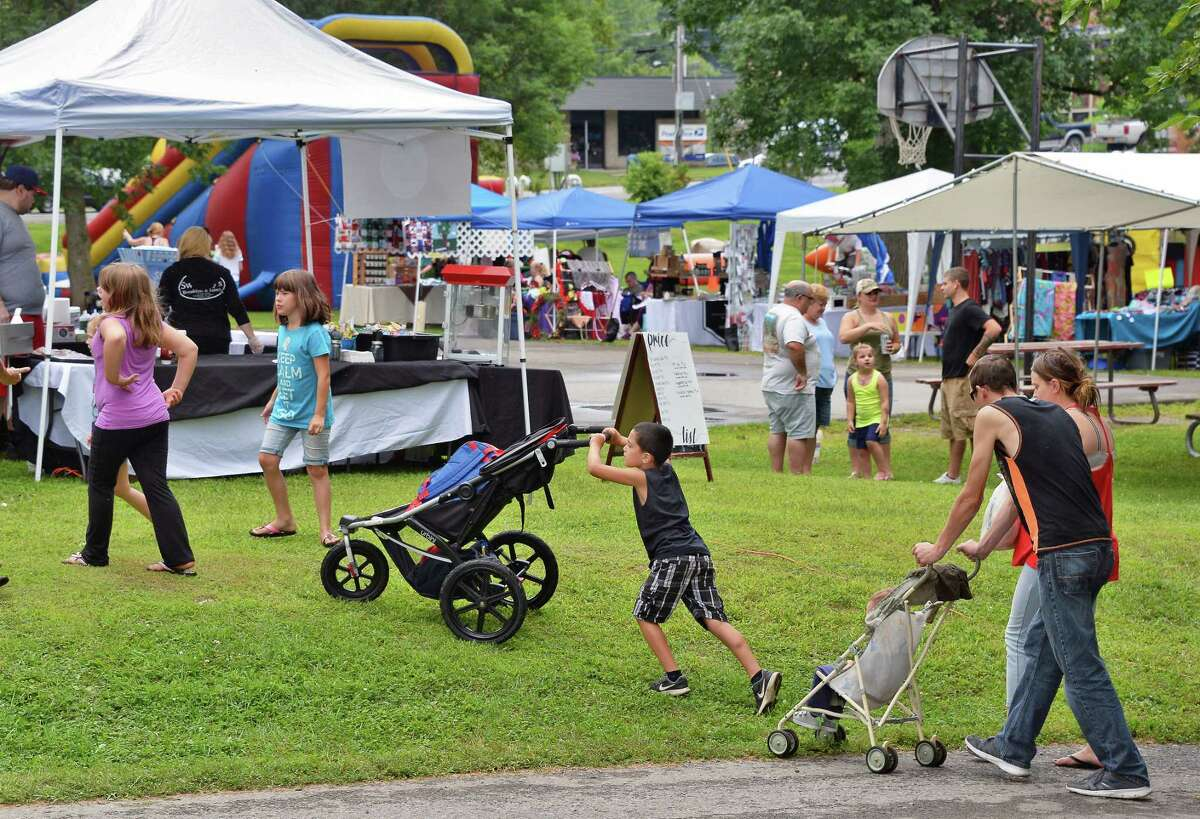 The rain over, families flock to the The Turning Point Festival, commemorating the American Victory at the Battle of Saratoga during the American Revolutionary War at Fort Hardy Park Saturday August 5, 2017 in Schuylerville, NY. (John Carl D'Annibale / Times Union)