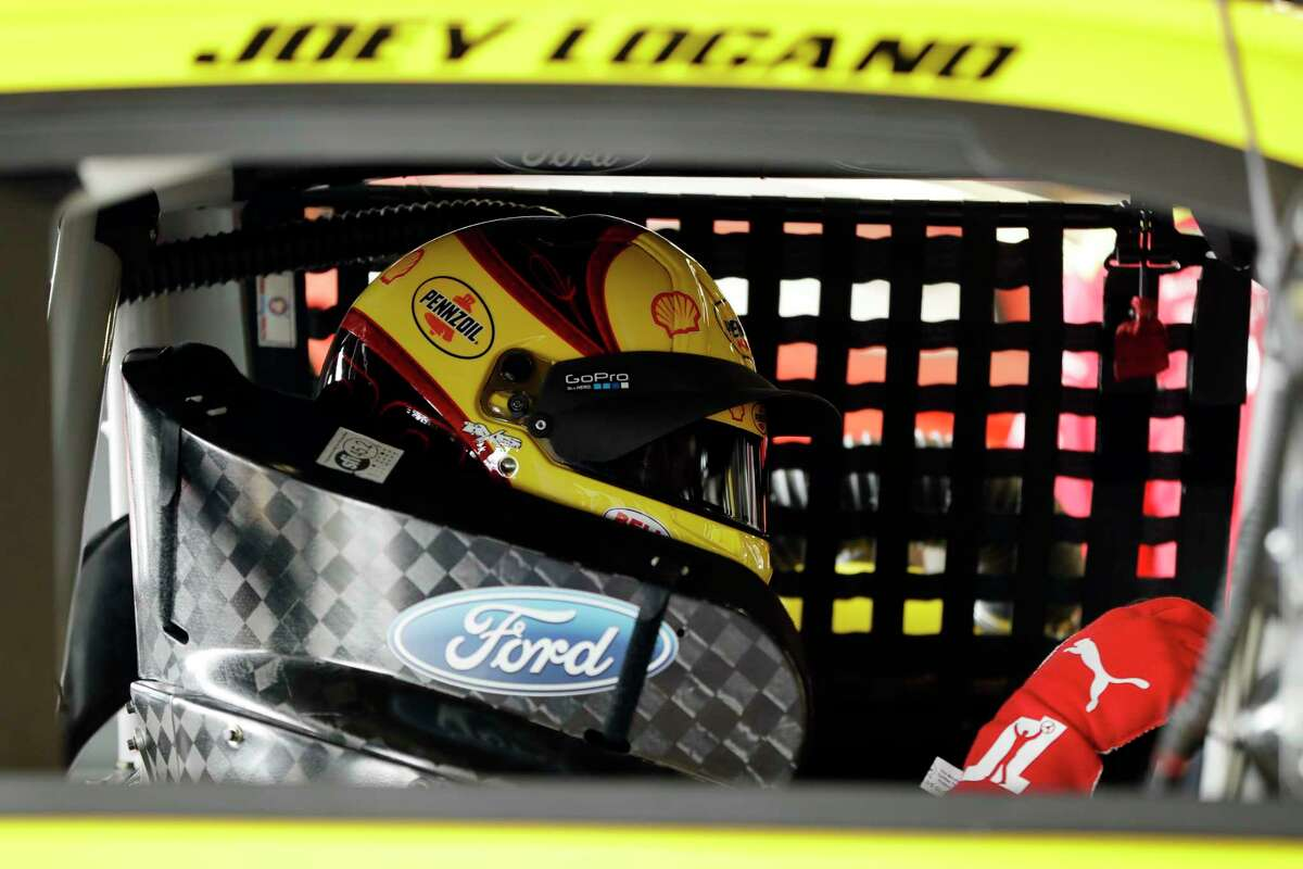 Joey Logano sits in his car during practice for Sunday's NASCAR Cup Series auto race, Saturday, Aug. 5, 2017, in Watkins Glen, N.Y. (AP Photo/Matt Slocum)