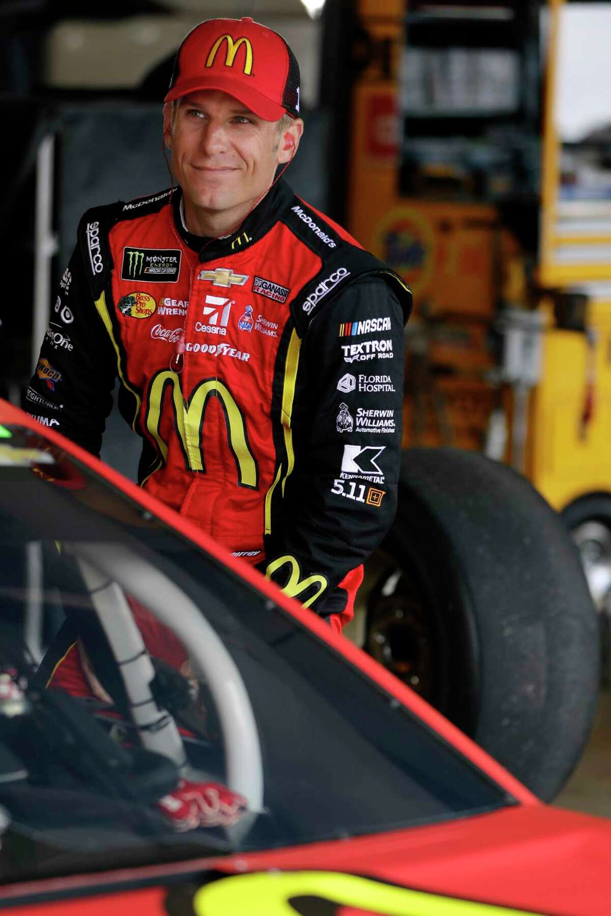 Jamie McMurray climbs into his car for practice for Sunday's NASCAR Cup Series auto race, Saturday, Aug. 5, 2017, in Watkins Glen, N.Y. (AP Photo/Matt Slocum)