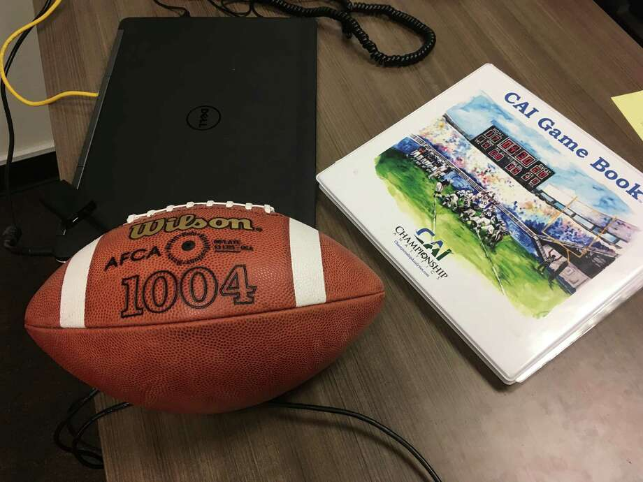 A CAI Game Book lies on a desk at Fordham University in New York, Thursday, Aug. 3, 2017. When it comes to NCAA college football in-game strategy, a six-year-old company named Championship Analytics, Inc., is quickly making a mark. CAI has gone from three schools subscribing to its service in 2014 to 53 this year, including 38 FBS teams. Using a patented system of statistical analysis, CAI provides its clients each week with a game book, a three-ring binder stuffed with pages of color-coded charts and a by-the-numbers breakdown of the matchup. Taking strengths and weaknesses of each team into account, the game book lays out possible scenarios and gives strategic recommendations based on which option provides the best odds of winning. (AP Photo/Ralph Russo) Photo: Ralph Russo, STF / AP