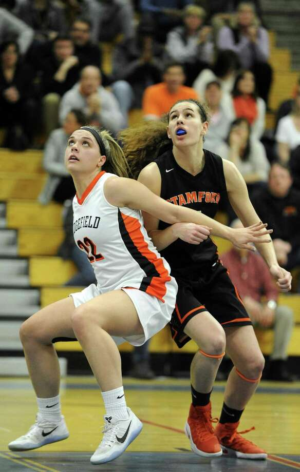 Ridgefield Caroline Curnal and Stamford Andrea O'Connor battle for position in the paint in a FCIAC girls basketball semifinal at Ludlowe High School in Fairfield, Conn. on Feb. 21, 2017. Stamford defeated Ridgefield 59-52. Photo: Matthew Brown / Hearst Connecticut Media / Stamford Advocate