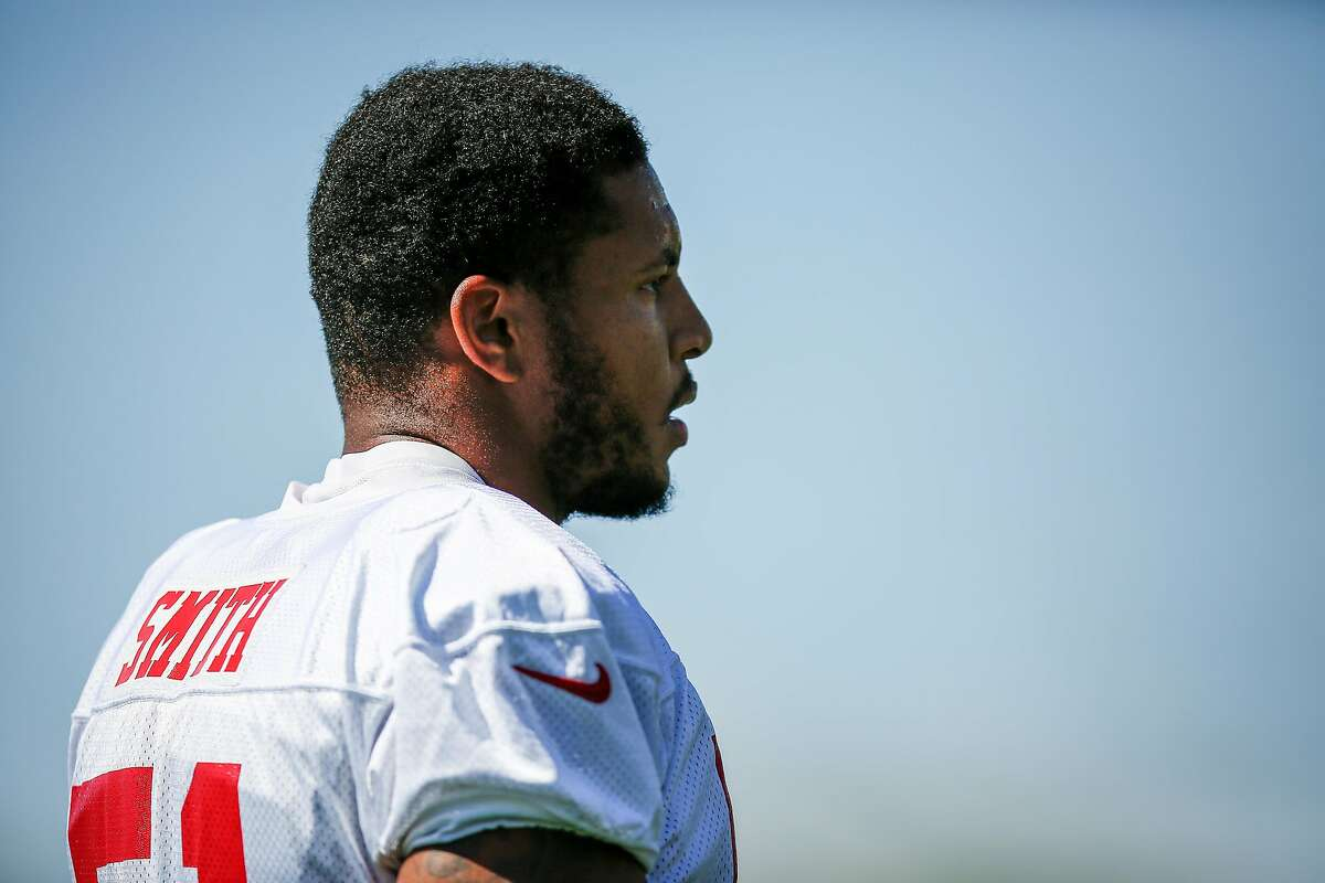FILE - San Francisco 49ers linebacker Malcolm Smith takes a break during practice on the practice field at Levis Stadium in Santa Clara in this file photo from Saturday, July 29, 2017.