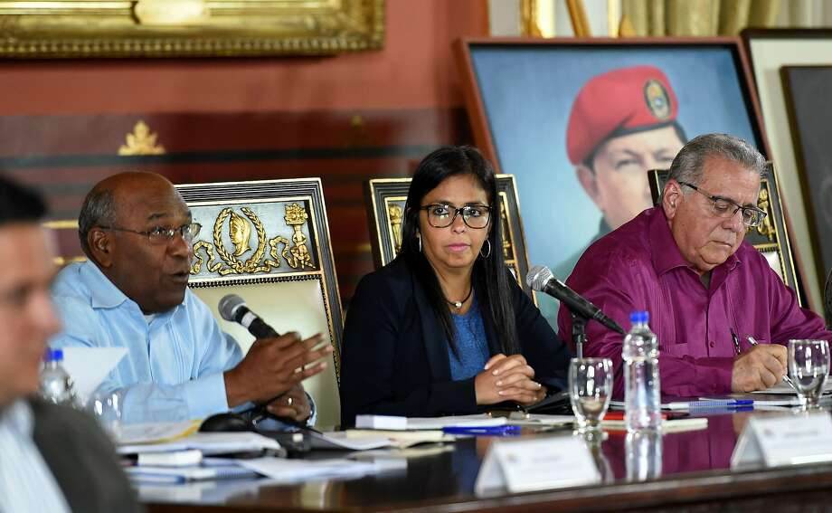 The president of the new Venezuelan Constituent Assembly, Delcy Rodriguez (C), its First Vice-President Aristobulo Isturiz (L) and Second Vice-President Isaias Rodriguez preside the first session of the controversial loyalist assembly, in Caracas on August 5, 2017. Venezuela's contested new assembly fired the country's dissident chief prosecutor Ortega, one of President Nicolas Maduro's most vocal critics, on Saturday in a move sure to provoke greater international criticism. The body, which made the sacking its first order of business, also said it planned to operate as Venezuela's supreme power for up to two years.  / AFP PHOTO / Juan BARRETOJUAN BARRETO/AFP/Getty Images Photo: JUAN BARRETO, AFP/Getty Images