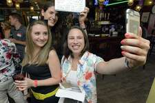 Jennifer Kelly of Stamford, Megan Floyd of Norwalk and Gina Sciame of Stamford snap a selfie together Tiernan's Pub & Restaurant during the first annual CageConn pub crawl on Saturday, August 5, 2017 in Stamford, Connecticut. Stamford millennials appear to be obsessed with the actor who received an Academy award for best actor in a leading role for his role in the film Leaving Las Vegas in 1995.