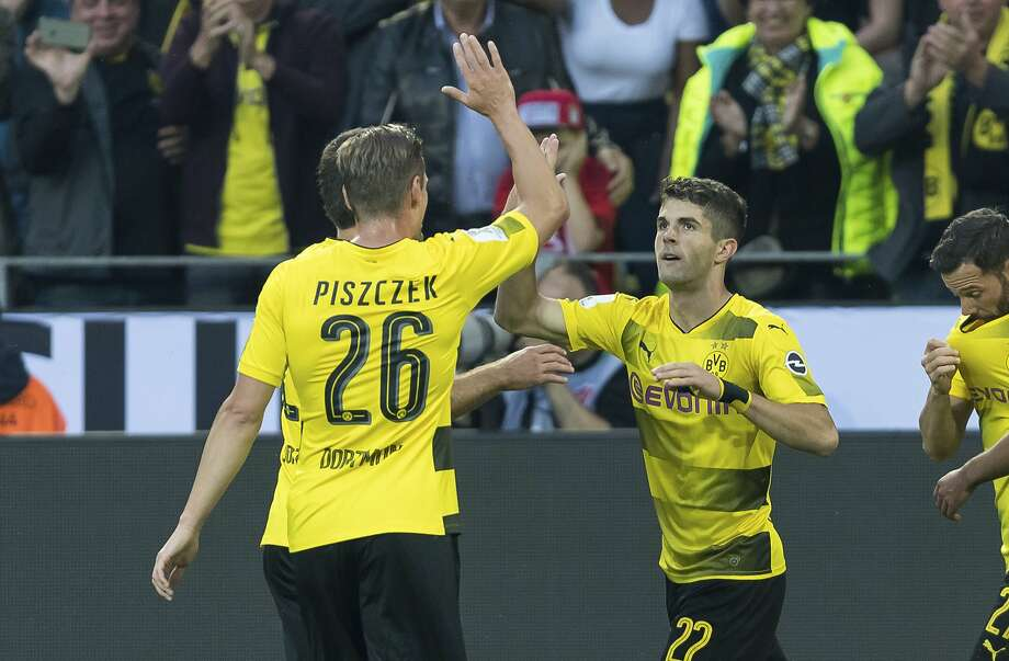 U.S. national team forward Christian Pulisic (22) gave his Bundesliga club Borussia Dortmund the early lead in the German Supercup. Photo: Marius Becker, Associated Press