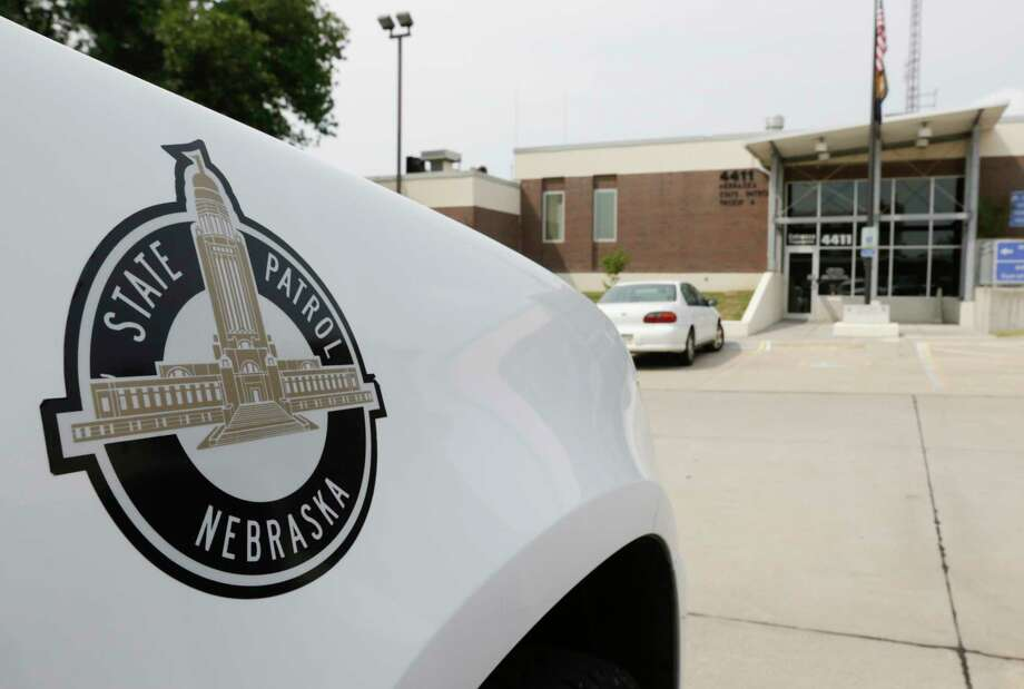 A vehicle with the Nebraska State Patrol logo is parked in a state patrol facility in Omaha, Neb., Wednesday, Aug. 2, 2017. A federal lawsuit accuses the Nebraska State Patrol that it has for years forced female recruits to submit to invasive, medically unnecessary pelvic exams performed by a male doctor before they can be hired. (AP Photo/Nati Harnik) Photo: Nati Harnik, STF / Copyright 2017 The Associated Press. All rights reserved.