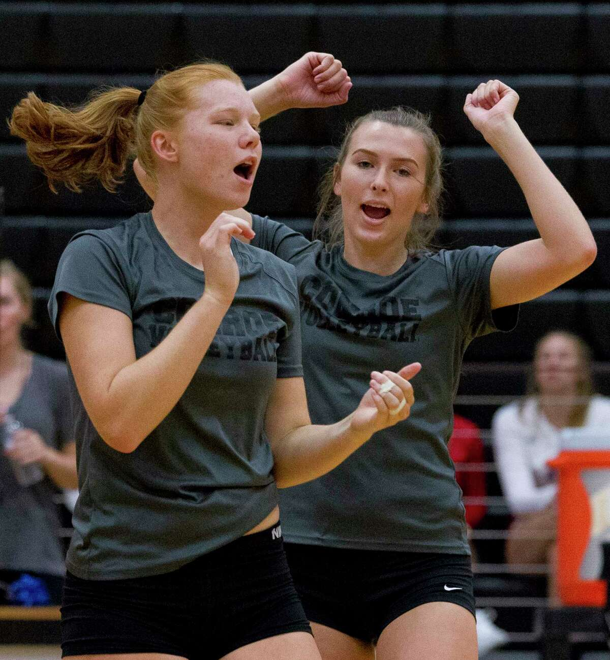 Jozy Rodel of Conroe celebrates after scoring a point during a high school volleyball scrimmage at Porter High School, Friday, Aug. 4, 2017, in Porter.