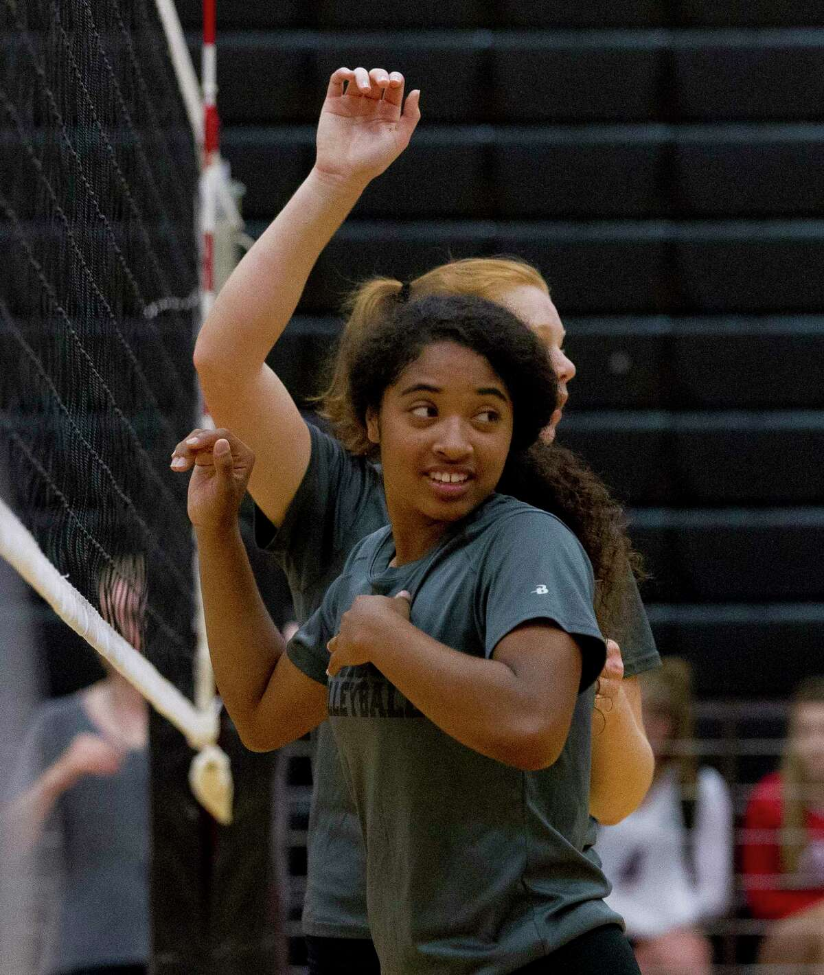 Jazzmin Kim waits for a serve at the net with Jozy Rodel during a high school volleyball scrimmage at Porter High School, Friday, Aug. 4, 2017, in Porter.
