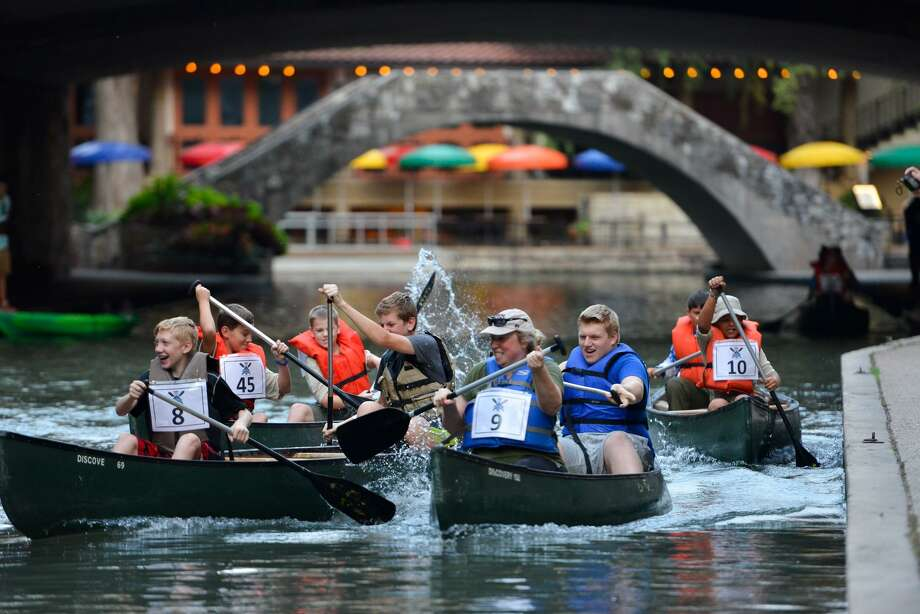 Scouts and their leaders paddle canoes along the San Antonio River during the Ford River Race. Photo: Robin Jerstad /For The San Antonio Express-News