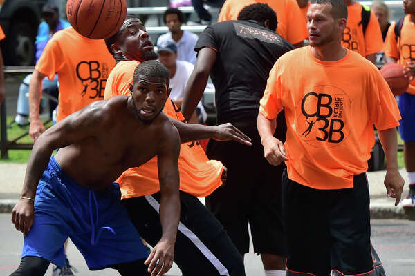 (Peter Hvizdak / Hearst Connecticut Media) New Haven, Connecticut: August 5, 2017.  The Connecticut Big Three Ball Out 3-on-3 basketball tournament with teams from New Haven, Hartford, Bridgeport and Waterbury Saturday, with 16 basketball courts on a blocked off Church Street in front of New Haven City Hall. The tournament is organized and run by the City of New Haven.
