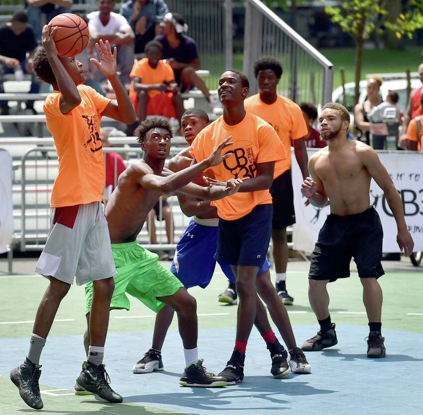 (Peter Hvizdak / Hearst Connecticut Media) New Haven, Connecticut: August 5, 2017. The Connecticut Big Three Ball Out 3-on-3 basketball tournament with teams from New Haven, Hartford, Bridgeport and Waterbury Saturday playing on16 basketball courts on Church Street in front of New Haven City Hall. The tournament is organized and run by the City of New Haven.