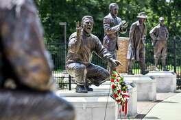 A wreath is displayed in front of a statue of Ara Parseghian, part of Miami University's Cradle of Coaches, Wednesday in Oxford, Ohio. Parseghian died Wednesday. He was 94.